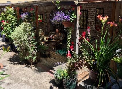 Customer Jacquie Burr enjoys the patio that she calls a _sanctuary._